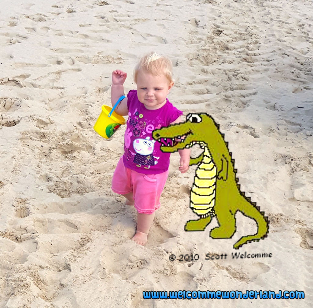 Image of a baby walking on the beach with Ajay the alligator holding her hand. Precious memories being created- part of what Welcomme Wonderland is all about.