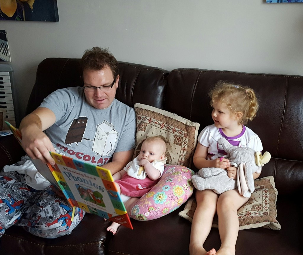 Reading with Daddy. Enjoying some well- deserved family time together when baby was younger- who would have thought Welcomme Wonderland would have grown so much since then?!