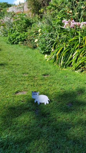 You think it's an nice Image of an English country garden but when you see it....Harris the little grey hippo as`Flat Harris' from Welcomme Wonderland. That cute hippo gets everywhere!