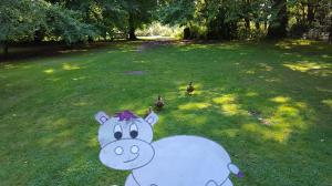 Another image of Harris the little grey hippo from Scott Welcomme's Welcomme Wonderland out and about playing duck duck duck Harris!