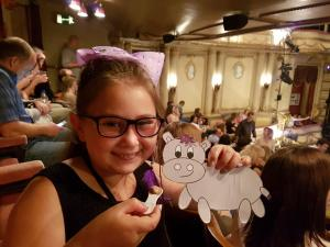 Harris the little grey hippo from Welcomme Wonderland eating a cheeky ice cream at the interval on his adventure at the Noel Coward Theatre- performance of Half a Sixpence